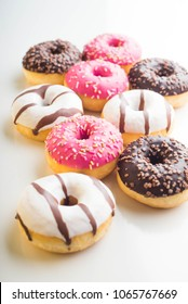 chocolate donuts on a white background