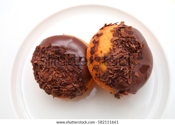 chocolate donuts on the white plate