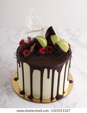 Chocolate Drip Cake With And Macaron Garnishes