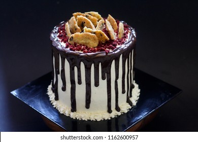 Chocolate dripping cake with cookies on top
