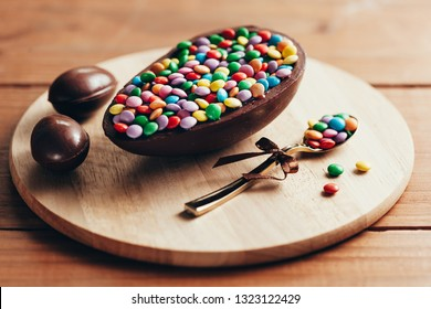 Chocolate Easter Egg on wooden background. Easter concept