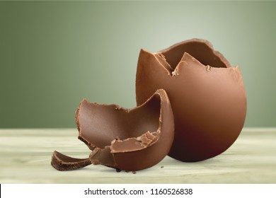 Chocolate Easter egg with the top broken