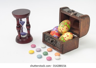 Chocolate Easter eggs in a wooden coffin on the white background.