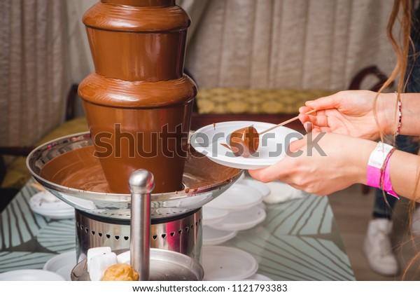 Chocolate eclair with ingredients on dark background