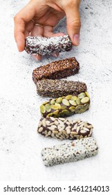Chocolate energy protein bars with nuts, seeds, dry fruits. Healthy dietary snack. Vegan dessert. Chia, flax seeds, coconut, sesame, pumpkin, sunflower seeds.