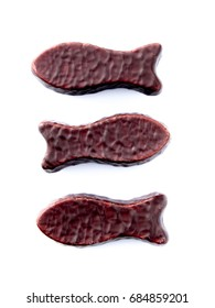Chocolate fish swimming in opposite directions isolated on white background - kiwiana lollies popular in New Zealand, NZ