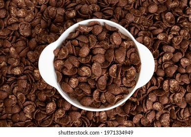 chocolate flakes in bowl on flakes background, healthy breakfast concept, plate of cornflakes