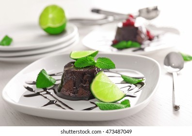 Chocolate fondant cake with mint and lime on the plate