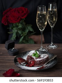 Chocolate fondant cake with red filling. Roses and wine — proposal of marriage