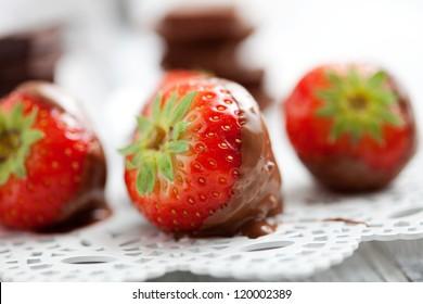Chocolate fondue with fresh strawberries, selective focus