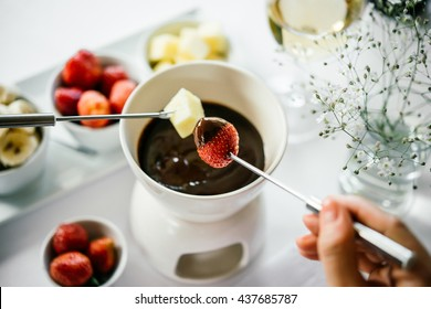 Chocolate fondue with fruits served in a restaurant