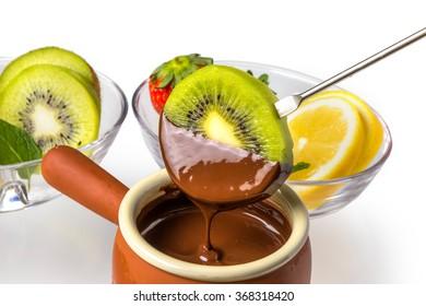 Chocolate fondue of the kiwi fruit