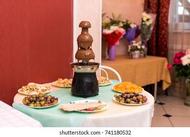 chocolate fountain on the festive table