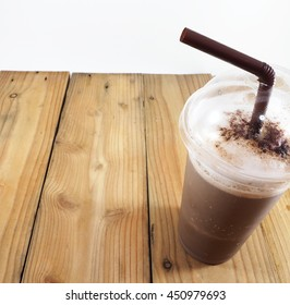 chocolate frappe on wooden table