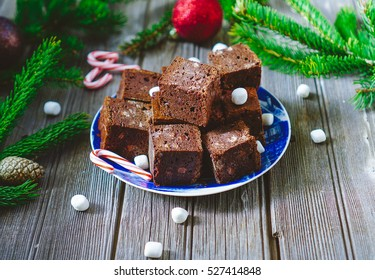 Chocolate fudgy brownies with marshmallows and candy. Christmas time, holiday baking, festive dessert. Selective focus, toning.