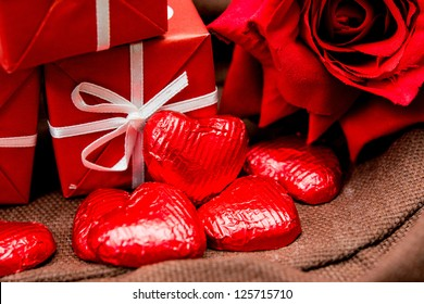 chocolate, gift box and flowers for Valentine's day