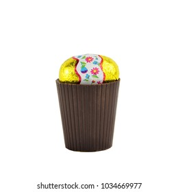 Chocolate glass with easter egg on it isolated