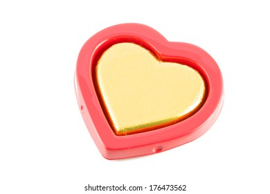 chocolate golden heart shape on red box on white background