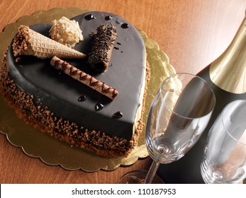 Chocolate heart cake and champagne bottle