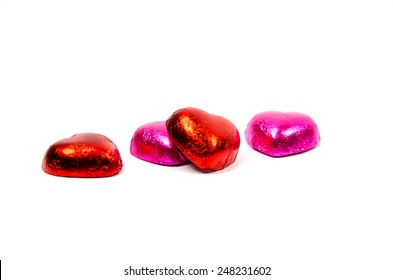 chocolate hearts candies on white background