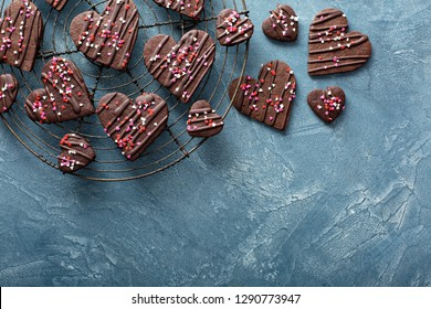 Chocolate hearts cookies for Valentines day with glaze and sprinkles overhead shot