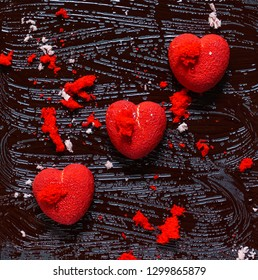 chocolate hearts on the black background