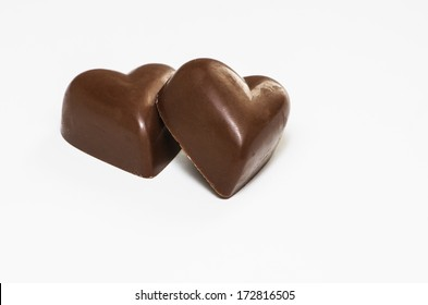 Chocolate hearts on white background
