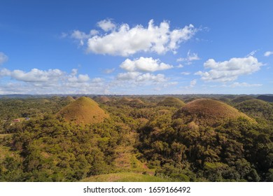 Chocolate Hills in the Bohol island in the Philippines, covered in brown grass. Famous touristic place.
