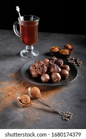 Chocolate homemade truffle sweets at dark background