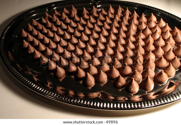 chocolate kisses all lined up on a silver tray