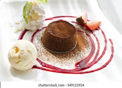 Chocolate lava cake with fruit and ice cream