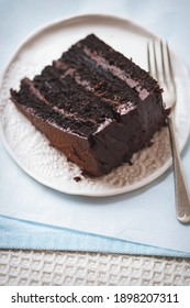 Chocolate layered cake. Dark chocolate cake made on buttermilk and cola