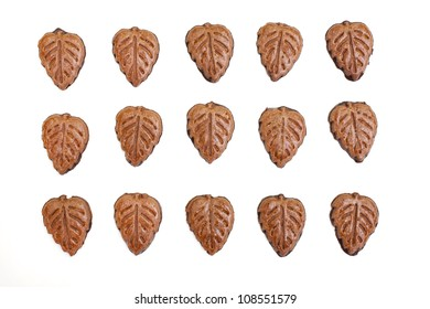 chocolate leaf shaped cookies isolated on white background