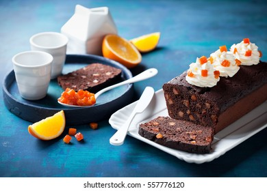 Chocolate loaf cake with orange candied fruits, selective focus