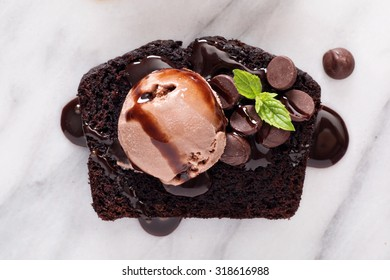 Chocolate loaf cake slice decorated on a marble board