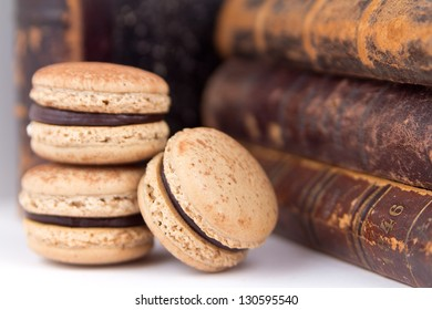 chocolate macaroon close up against old books
