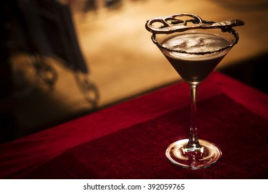 Chocolate martini cocktail drink in bar at night