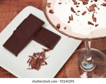 chocolate martini garnished with chocolate power rim and chocolate shavings on cream