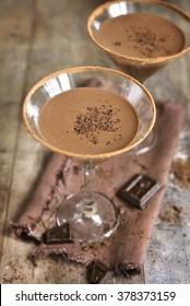 Chocolate martini in a glass on rustic background.