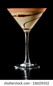 chocolate martini isolated on a black background with chocolate swirl and cocoa powder on the rim