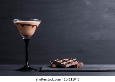Chocolate martini on the wooden background