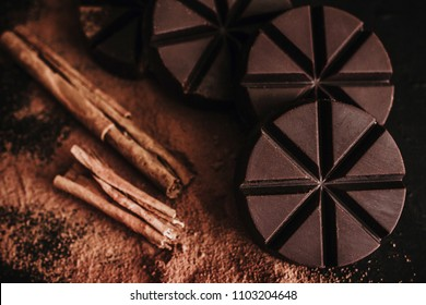 chocolate mexicano, cinnamon sticks and mexican chocolate from oaxaca mexico on wooden in rustic style