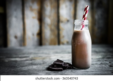Chocolate milk in a jar on wooden background