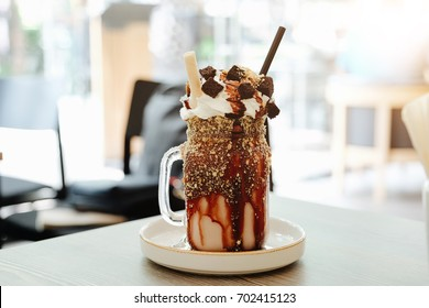 Chocolate milk shake with whipped cream with jar in cafe