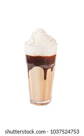 Chocolate milkshake with chunks of chocolate and cookies on top, isolated on white.