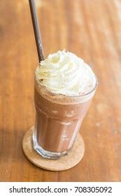 chocolate milkshake with whipped cream in cafe