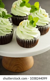 Chocolate mint cupcakes with light green frosting and edible golden leaf