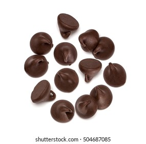 Chocolate morsels spread from top isolated on white background from top