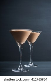Chocolate mousse in martini glass on the wooden background