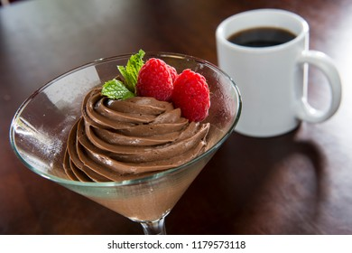 Chocolate Mousse with Mint, Raspberries and Coffee served in a glass dish